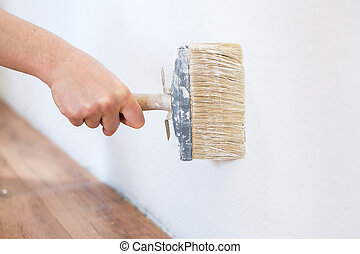 Painting the walls in the room using brush