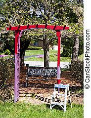 Painting Trellis in Garden Red