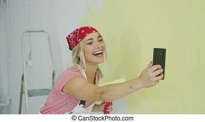 Painting wall woman taking selfie