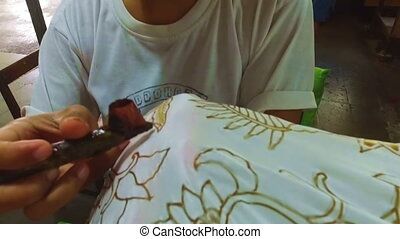 Painting watercolor on the fabric to make batik in Indonesia