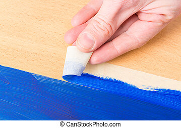 Painting with masking tape - Hand removing masking tape also...