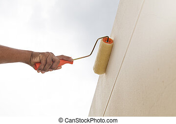Painting with roller on wall