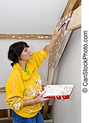 Painting woman - A woman painting a newly restored room
