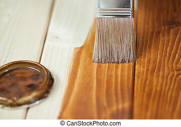 Painting wooden boards during renovation at home