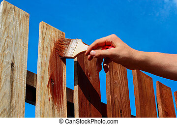 Painting wooden fence