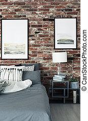 Paintings in modern bedroom interior
