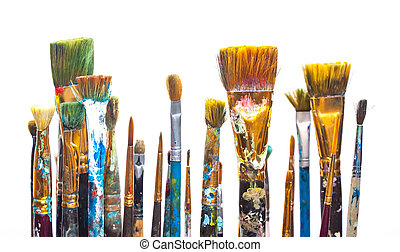 Paints and brushes on white background