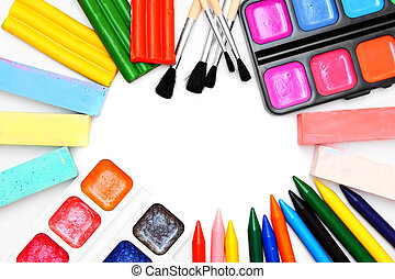 Paints and brushes .