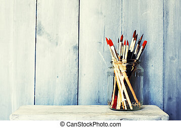 Paints and brushes  - Photo of paint brushes in a jar