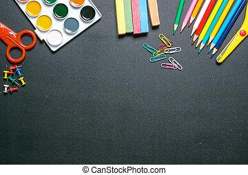 paints, scissors, pencils and chulks on black chalkboard 2