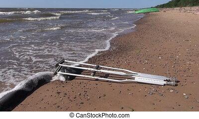 pair crutch on sea beach sand