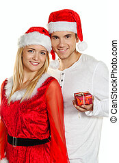 pair for christmas with caps - young couple at christmas...