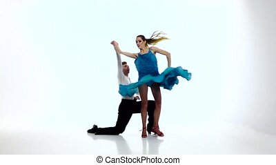 Pair graceful dancers perform jive on white background, slow...