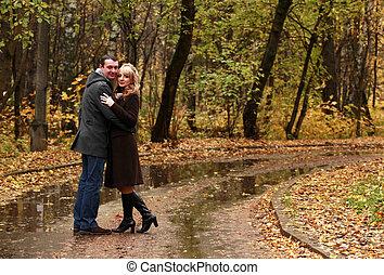 Pair in autumn park