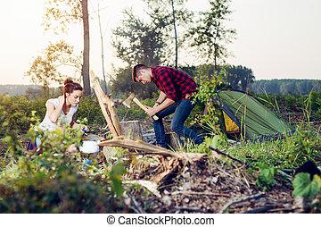 Pair in love prepare grill fire in wood