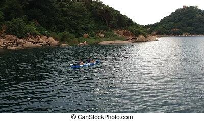 Pair Kayaking near Shores of Lake Malawi
