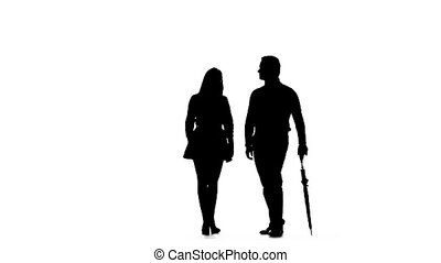 Pair kissing under the umbrella. Silhouette. White background. Slow motion