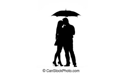 Pair kissing under the umbrella. Silhouette. White...