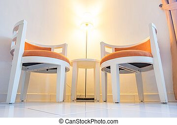 Pair of arm chair in living room for relaxing with floor lamp.