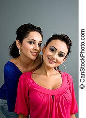 pair of attractive latinas