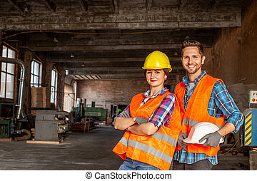 Pair of attractive workers indoors woodworking workflore