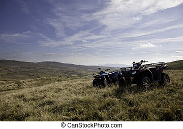 Pair of ATV quad bikes on lonely mountain - Adventure on...