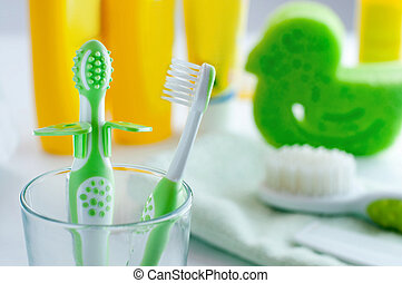 Pair of baby first toothbrushes in the bathroom