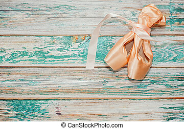 Pair of ballet shoes on old stage
