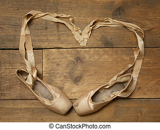 Pair of Ballet Shoes on Wooden Floor - Pair of ballet shoes...