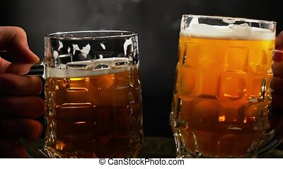 Man and woman hands put pair of beer mugs on the table