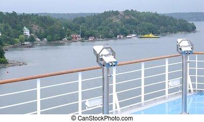Pair of binoculars on ship, time lapse