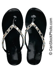 Pair of black beach sandals in rhinestones, isolated on white background.