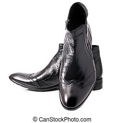 Pair of Black leather mens boots on white