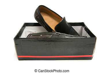 Pair of black male shoes in box isolated on white