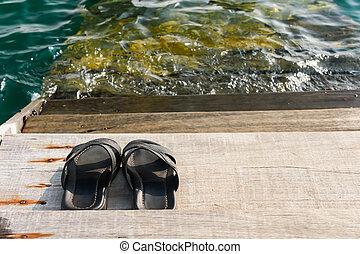 pair of black mens sandals