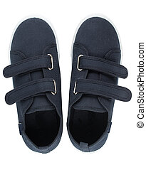 Pair of blue sporty sneakers, gumshoes for boy isolated on a white background, close up, top view