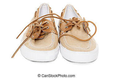 Pair of boat shoes isolated on white front view