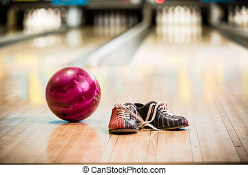Pair of bowling shoes and ball