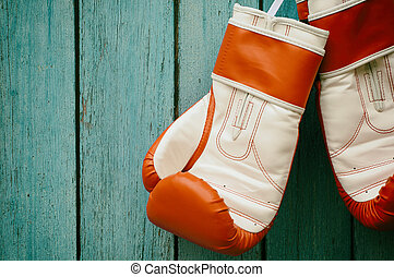 Pair of  Boxing Gloves Hanging on a Hook