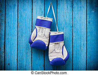 pair of boxing gloves hanging on a nail