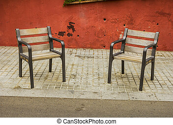 Pair of chairs - A pair of chairs on a street