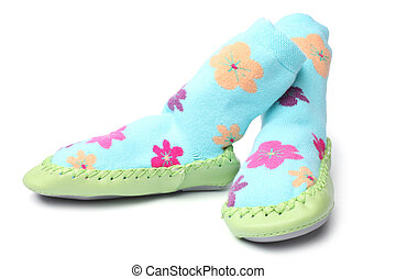 Pair of children's bootees on white background