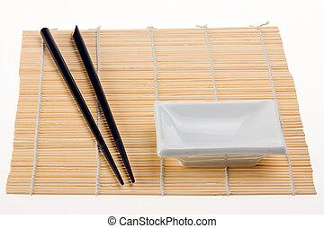 pair of chopsticks on a b