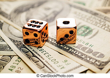 Pair of Copper Dice on Money - Hundred dollar bills with...