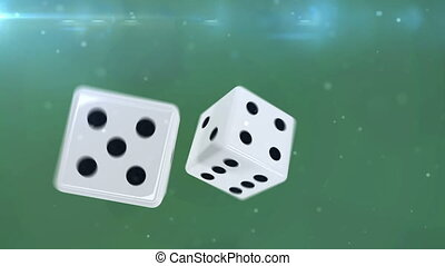 """Pair of dice is rolling in slow motion against a green..."