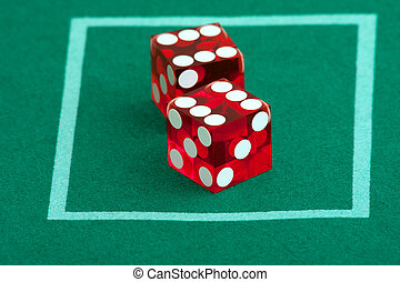 pair of dice on casino felt