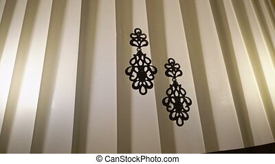 Pair of earrings indoors closeup