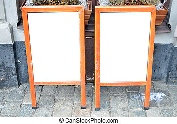 Pair of empty menu boards at street