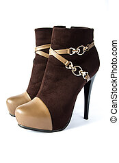 Pair of fasionable brown susede women boots with high heels