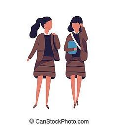 Pair of girls dressed in school uniform. Female students,...